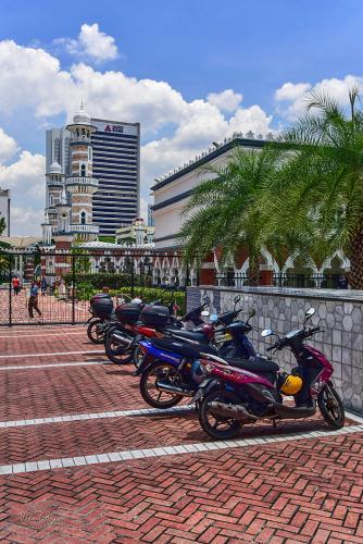 Kuala Lumup street with bikes outside mosque 12x