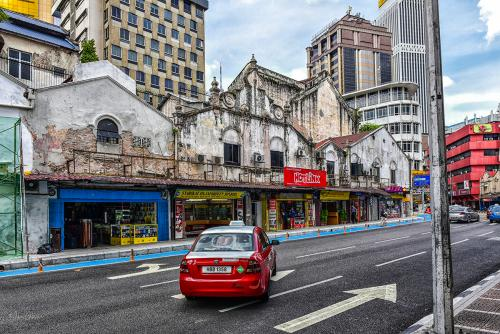 Kuala Lumup street with red taxi 12x