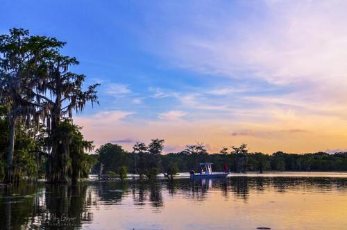 Lake Martin Louisiana sunset with boat 12x18