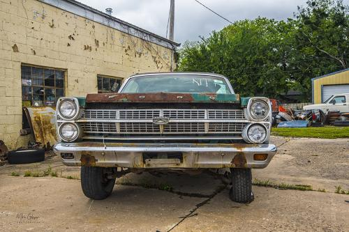 Rusting Ford car 12x