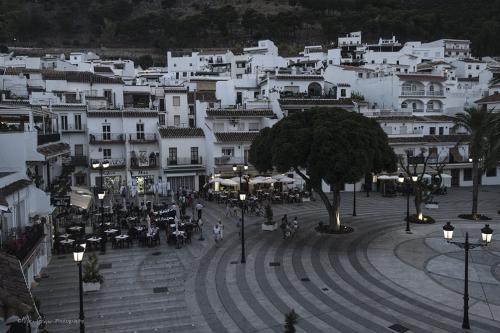 looking down at Mijas town square at dusk 2 12x
