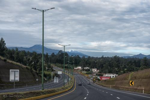 Leaving Quito with Antisana and Cotopaxi in the distance
