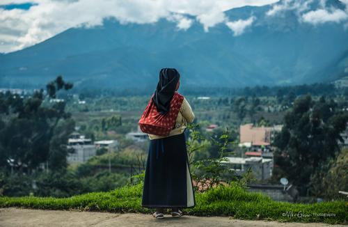 Girl staring into countryside, Ecuador